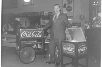 High Country Founder L.E. Messinger poses with a beverage cooler from the 1950's.
